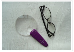 magnifier and glasses