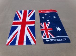 Australian and UK towels on the beach