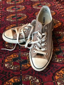 well-worn Converse trainers